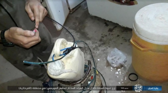 ISIS operative makes an IED at the house of the mukhtar.