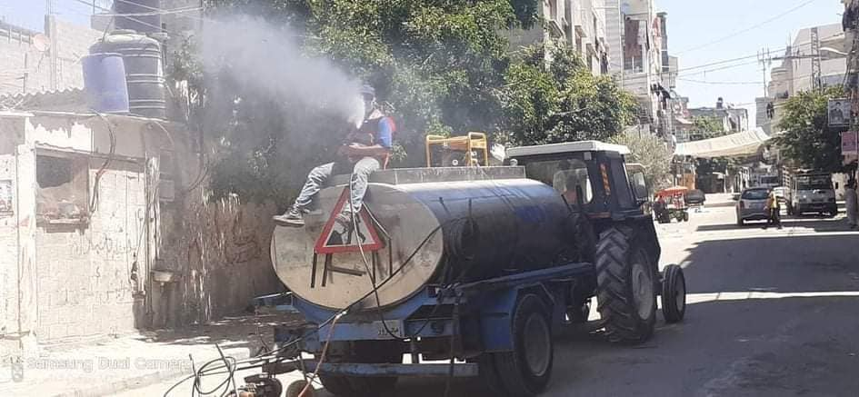 Disinfecting the al-Maghazi refugee camp, where the first Covid-19 cases inside the Gaza Strip were detected (Facebook page of photojournalist Usama al-Kahlut, August 25, 2020)