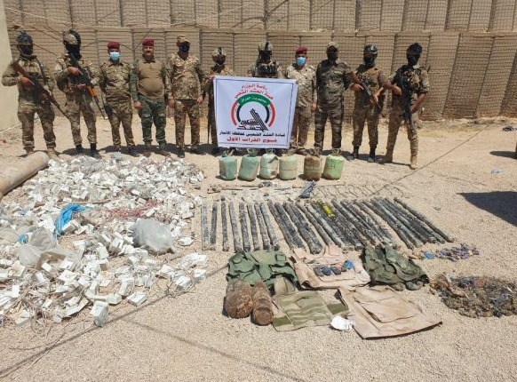 Popular Mobilization fighters near ordnance found in the Anbar Province (al-hashed.net, August 30, 2020)