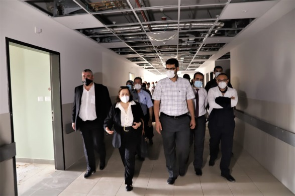 The delegation's visit to the Shifaa Hospital and the central laboratory. Third from the left is deputy minister of health in Gaza, Dr. Yusuf Abu al-Rish (Facebook page of the ministry of health in Ramallah, September 6, 2020).