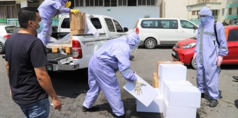 A PCR machine and swabs donated by Qatar's National Committee for the Reconstruction of Gaza (Committee website, September 1, 2020).
