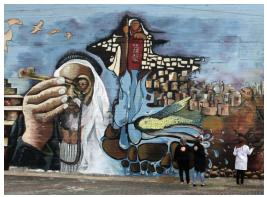 "Following is the piece as appearing in the 2017 edition (p. 79): ""in 2013, the city of Nablus dedicated the largest mural that expresses the history of the Palestinian cause, with the participation of 25 artists, both male and female…"":"