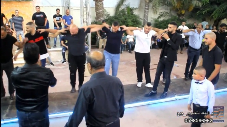 Guests dance during a wedding on the Palestinian side of Barta'a. No masks and no social distancing YouTube, October 22 and 23, 2020).