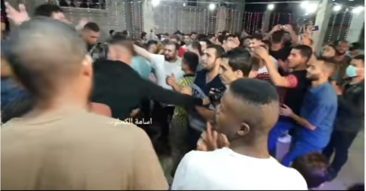 Mass violations of ministry of health preventive measures, Right: A wedding in a refugee camp in the central Gaza Strip (Facebook page of photojournalist Usama al-Kahlut, October 28, 2020).