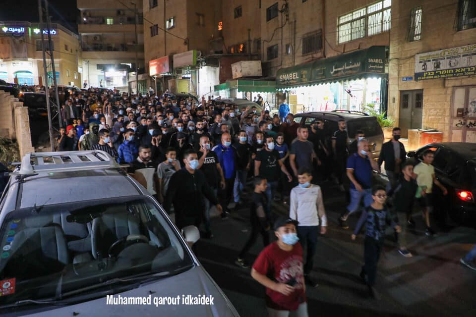 Parade held in the Sur Baher neighborhood of east Jerusalem to mark Muhammad's birthday. Masks, no social distancing (Facebook page of east Jerusalem photojournalist Muhammad Qarout Idkaidek, October 29, 2020).