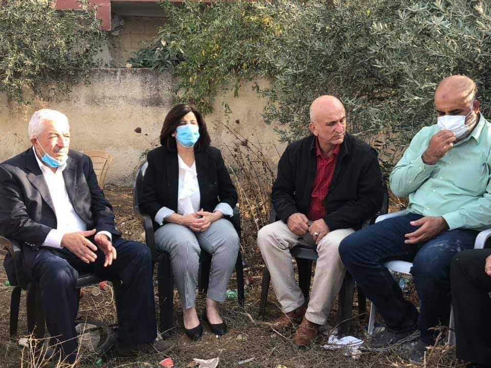 A Fatah delegation sits with the family near the ruins of the house. Few masks, no social distancing (Rujeib Facebook page, November 2, 2020).