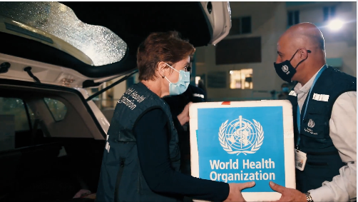 The W.H.O. director in Gaza delivers the test kits (Facebook page of the W.H.O. office in the territories, November 1, 2020).