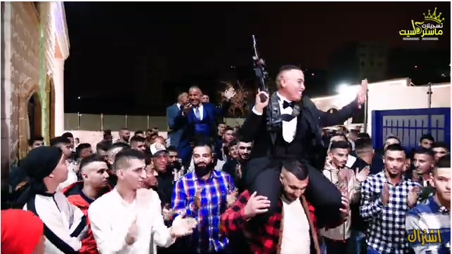 A wedding in Issawiya in east Jerusalem. The groom is carrying an M-16 assault rifle. No masks, no social distancing (Master Cassette YouTube channel, November 14, 2020).