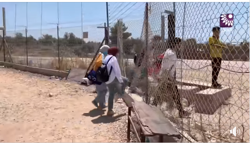 Palestinians pass through the security fence in Faroun, south of Tulkarm, through holes in the fence for a visit to Israel (al-Fajr TV Facebook page, August 7, 2020).