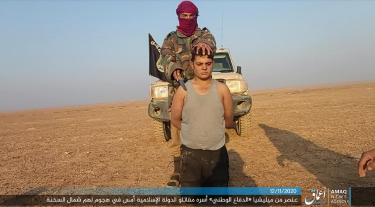 Fighter of the Homeland Defense Forces being executed by an ISIS operative (an Amaq photo as posted on Telegram, November 12, 2020)