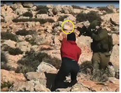 Rock (yellow circle) thrown at an IDF officer during riots in the village of Mughayir on December 11, 2020 (QudsN Facebook page, December 11, 2020).