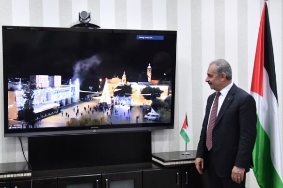 PA Prime Minister Muhammad Shtayyeh watches the tree-lighting via video conference (Wafa, December 5, 2020).