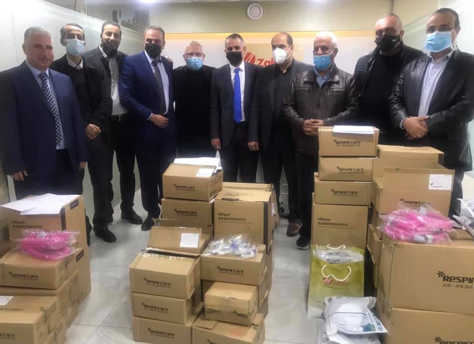 Jibrin al-Bakri, governor of the Hebron district, delivers ventilators and other medical equipment to three government hospitals in the district (Facebook page of the Hebron district governor, December 13, 2020).