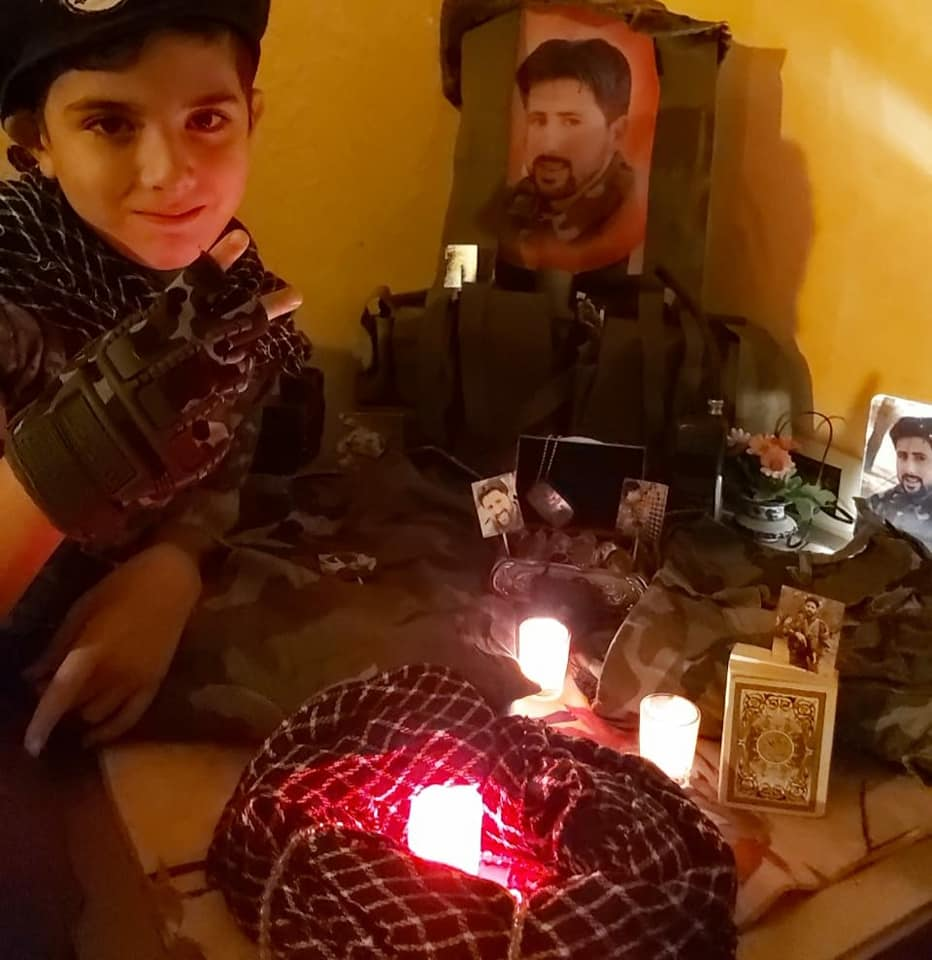 Propaganda activity at the school: the son of Hezbollah shaheed Jamil Hussein Faqih displaying objects related to his father as part of the Shaheed Day 2020 activity at the Al-Mahdi School in Bint Jbeil (Facebook page of the Al-Mahdi School in Bint Jbeil, November 11, 2020).