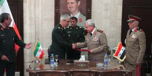 The signing of the agreement on military cooperation between Iran and Syria (ISNA, July 14, 2020).