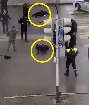 Members of the Russian security forces next to the two policemen stabbed by ISIS operatives (@nofficial MOSSAD Twitter account, December 28, 2020).