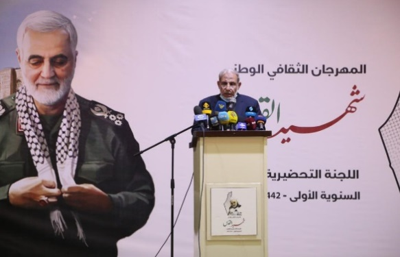 Senior Hamas official Mahmoud al-Azhar (right) and senior Palestinian Islamic Jihad official, Khaled al-Batash (left) give speeches at an event in Gaza commemorating Qasem Soleimani (PalToday, January 4, 2021)
