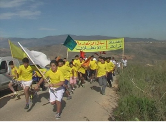 The 2012 race between the outposts of Ali al-Taher ridge east of Nabatieh. The race was held to commemorate the IDF's withdrawal from southern Lebanon. It ended in the reenactment of the waving of Hezbollah's flag above the IDF's Dlaat outpost on the Ali al-Taher ridge, on October 29, 1994 (Al-Khiyam website, May 31, 2012).