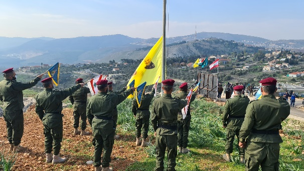 Hezbollah operatives swear loyalty to Hassan Nasrallah at a ceremony held on a hill opposite the northern Israeli village of Metulla (Twitter account of Ali Shoeib, January 3, 2021).