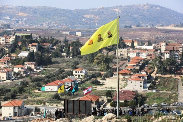 Hezbollah flag planed on a hill above Metulla with pictures of Qassem Soleimani, Abu Mahdi al-Muhandas and Imad Mughnieh (Alahad , January 3, 2021).
