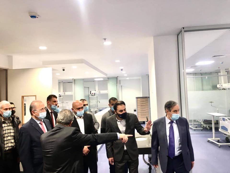 Muhammad Mustafa, director of the Palestinian Investment Fund, and the governor of the Jenin district tour the hospital (Facebook page of the Jenin district governor, January 5, 2021).