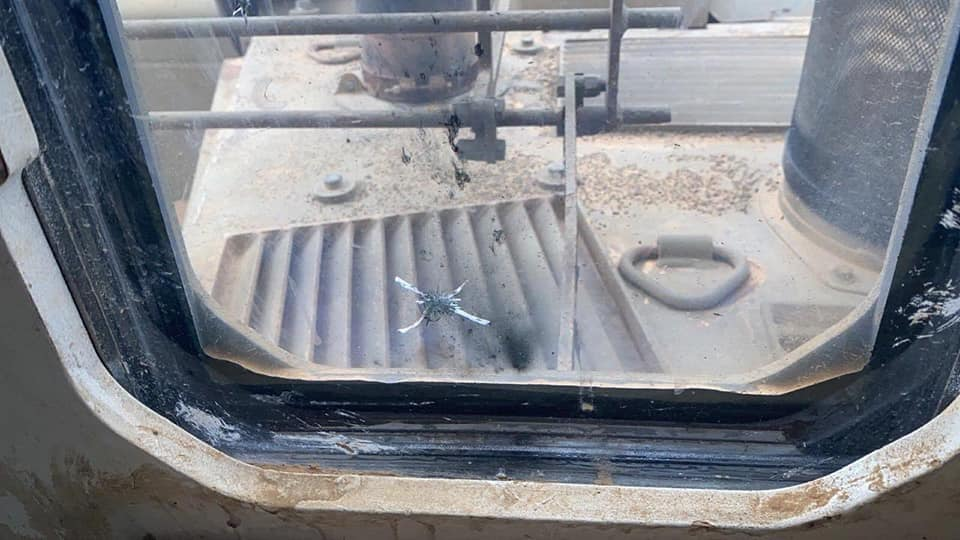 Holes in the front windshield of the cabin of the bulldozer (Palestine Online Twitter account, January 13, 2021).