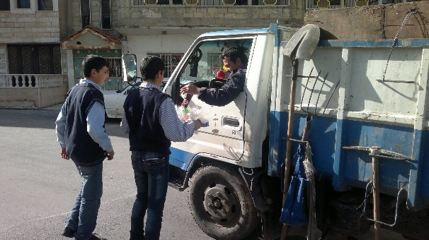 School students in Al-Khiyam distributing candies to drivers on the Al-Khiyam Prison road on the anniversary of the birth of the Prophet Muhammad in an event organized by the Education Mobilization (Education Mobilization, undated)