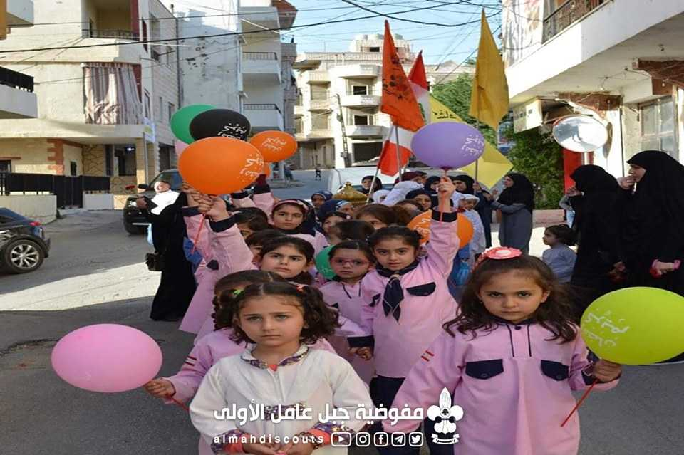 Boys and girls of Hezbollah's Imam Al-Mahdi Scouts in a parade marking the beginning of Ramadan in the town of Al-Khiyam (Imam Al-Mahdi Scouts website, undated)