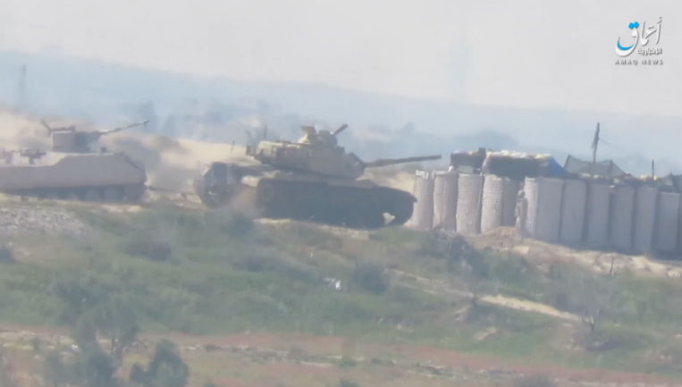 An Egyptian army tank removing the armored vehicle hit by ISIS's IED east of the village of Zuhur, south of Sheikh Zuweid (Amaq, as posted on Telegram, February 23, 2021)