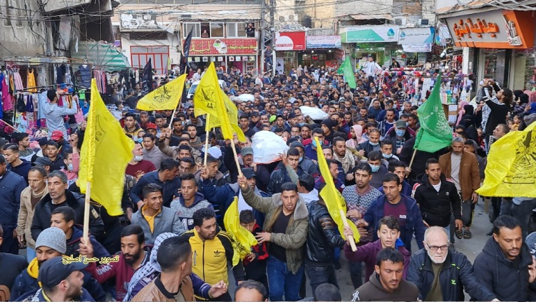 The funeral held in Khan Yunis for the three fishermen (Twitter account of journalist Hassan Aslih, March 7, 2021).