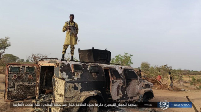 ISIS operative standing on one of the Nigerian army APCs that were destroyed.