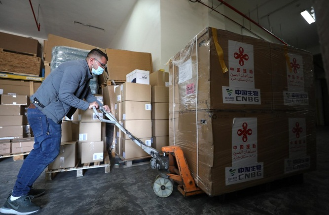 Storing China-donated Sinopharm vaccines in the logistic warehouses east of Nablus (Wafa, March 29, 2021).