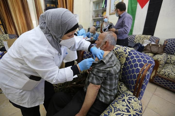 Palestinian medical personnel receive the vaccine (ministry of health in Ramallah Facebook page, April 5, 2021).