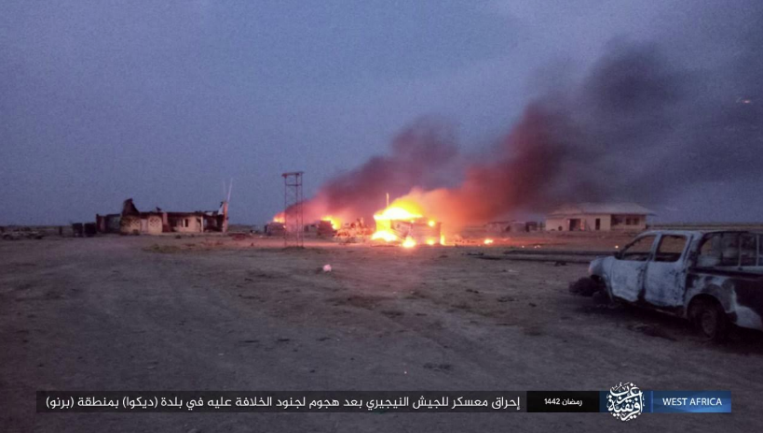 ISIS operatives setting fire to the base.
