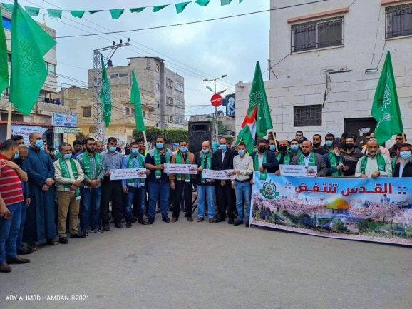 """Rally in support of rocket fire, Beit Hanoun, northern Gaza Strip. The sign reads, """"Jerusalem rises in rebellion."""