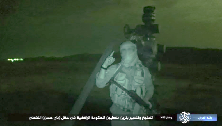 ISIS operative, with oil wells going up in flames in the background (Telegram, May 6, 2021)