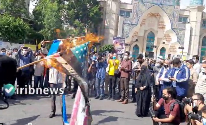The burning of Israeli and American flags to mark International al-Qods Day in Palestine Square in Tehran. (IRIB, May 7)