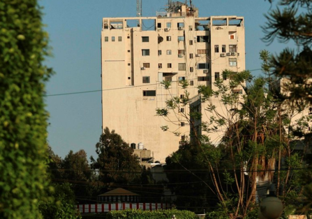 The Al-Shurouq Building in Gaza City before (Twitter account of journalist Hassan Aslih, May 13, 2021) and after the IDF attack (Twitter account of photojournalist Ashraf Abu Amra, May 1