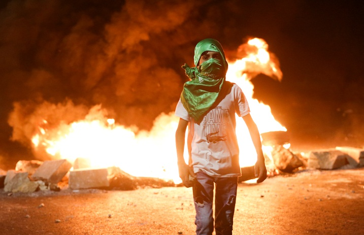 Palestinians riot against Israeli security forces at the northern entrance to Ramallah on May 12, 2021 (Wafa, May 13, 2021)