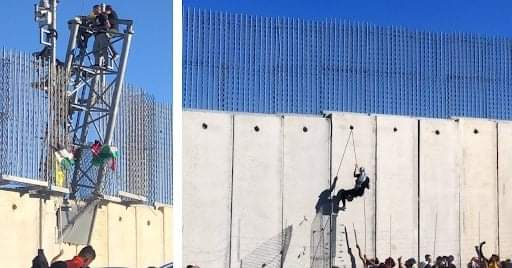Lebanese climb the border security fence in south Lebanon (Palinfo Twitter account, May 15, 2021).