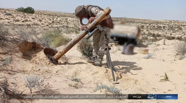 ISIS operative preparing to fire one of the mortar shells.