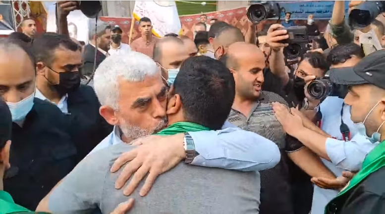 Yahya al-Sinwar visits the mourning tent erected for Bassem Issa and comforts one of his sons (Facebook page of journalist Ibrahim Ahmed, May 22, 2021).