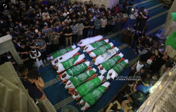 The fatalities in the Al-Omari Mosque in Gaza: 11 of the 13 bodies are covered with Hamas flags, including Wael Issa (Filastin al-Yawm, May 13, 2021).