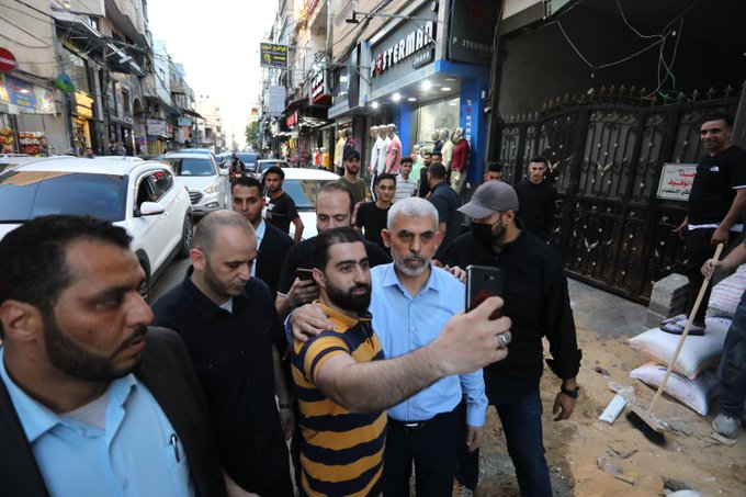 Yahya al-Sinwar walks to his house in Khan Yunis, demolished during the hostilities, after holding a press conference (Palinfo Twitter account, May 26, 2021).