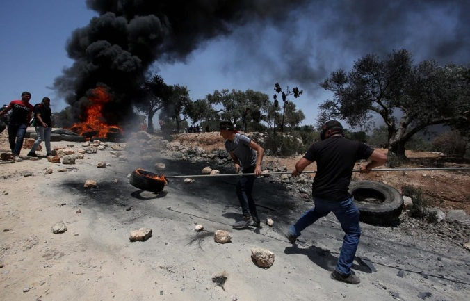 The weekly riot between Palestinians and the Israeli security forces at Jabal Sabih to protest the Israeli community of Eviatar (Wafa, June 11, 2021)
