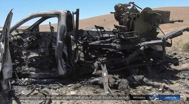 The Syrian army vehicle hit by ISIS.