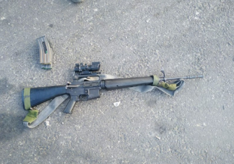 M-16 assault rifle taken from one of the wounded Palestinians (Israel Police Force spokesman's unit, July 12, 2021).