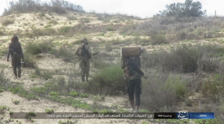 ISIS operatives planting IEDs