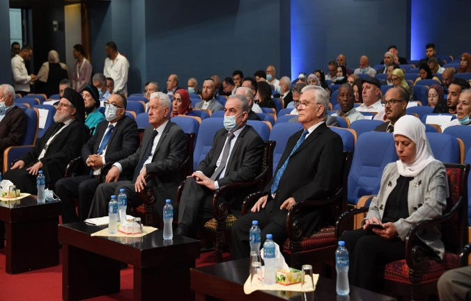The conference in Ramallah. According to the sign at the right, the conference was sponsored by Mahmoud Abbas (Wafa, June 29, 2021).