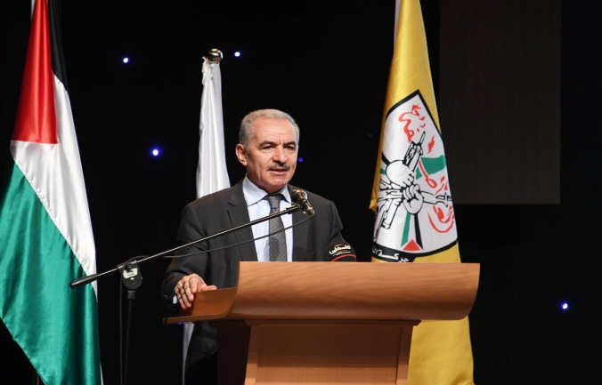 PA Prime Minister Muhammad Shtayyeh gives a speech at the conference (Wafa, June 29, 2021).